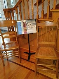 Cane bottom chairs (one - as is); music stand