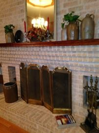 Brass fire screen, fireplace tools, mirror, and jugs