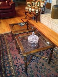 Two of three matching glass top coffee tables