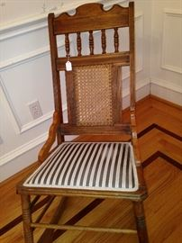 Striped upholstered antique rocker has a matching fabric settee