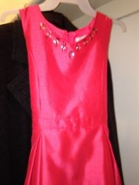Coral-colored silk shantung dress with jeweled neck line