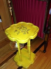 Small yellow plant stand
