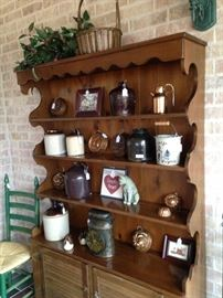 Maple hutch filled with vintage jugs