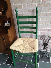 One of two ladder back chairs