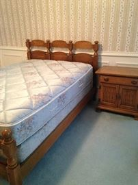 One of two twin beds; nightstand