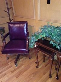 One of several desk chairs; hat rack;  stack tables