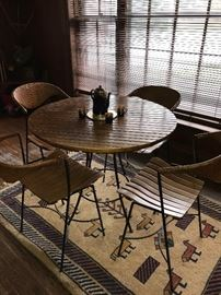 MCM WOODEN SLATS, WICKER AND METAL ROUND TABLE WITH 4 CHAIRS