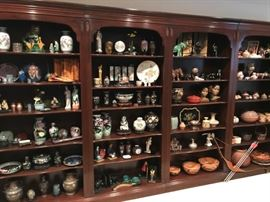 Shelving unit (not for sale) displaying a vast collection of decorative items.  Most are 'oriental'.