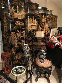 """Oriental screen, marble inset stands, and additional oriental design items.  On the back of the sofa to the right in the photo is a collection of """"Navajo"""" rugs."""