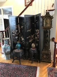 Oriental style screen, tall case clock, floor vase and more in the front hallway.  Rugs are for sale, too.