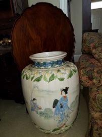 Oriental floor vase with flowers in relief