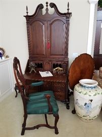 Solid and handsome secretary.  Arm chair. Oriental style floor vase. Piecrust edge tilt-top table in mahogany