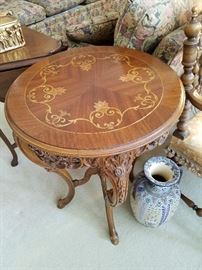One of a pair of inlaid top carved tables