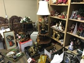 Wall to wall furniture along with Holiday and other decorations in a storage area....