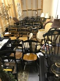 """A room full of sets of chairs, many are signed """"Hitchcock"""" and in excellent condition."""
