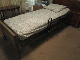Electric hospital bed in working condition