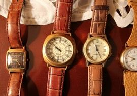 Watch brands include: Fossil (x2), Stauer (x2), Elgin (x2), Omega (x2), Breitling, Lassale, Guess, Seiko, Jaz Paris, Jean Bartin, Brighton, and DKNY....