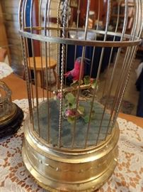 Antique singing bird automaton in gilded cage, working