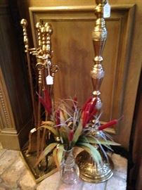 Brass fireplace tools and large brass candle holder