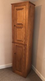 Matching tall, narrow cupboard storage -