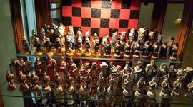9 different CHESS sets from around the world. Hand carved featuring different characters.