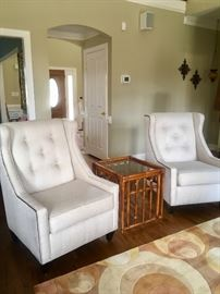Pair of matching wing back chairs