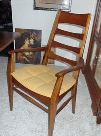 Heywood Wakefield dining table - both ends fold down  w/6 chairs, 2 leaves and pads - great condition.  w/matching hutch