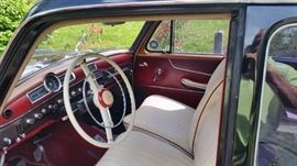 1958 4-door Mercedes Model 219 with Rolls-Royce front. Black with white interior trimmed in red.