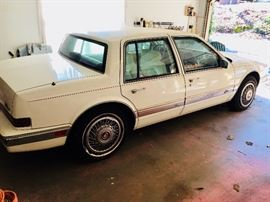 1991 Cadillac Seville with only 107k miles.  White, white leather interior and red carpet and dash.  Includes a newer cd player and 10 disc cd player.  See additional photos at the end of listing photos.