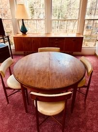 Mid Century table and chairs by V.B. Wilkins for G. Plan with a matching sideboard.