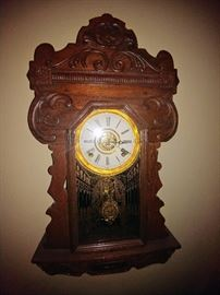 ornate antique wall clock