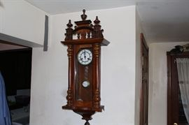 one of several antique clocks