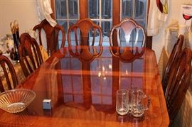 beautiful dining table w/ 2 leafs and 7chairs , matching china cabinet and buffet