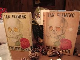 """James Bond Memorabilia including one of the two 1959 First Edition """"GoldFinger"""" with dust jackets published in London by Jonathan Cape. A 1st Edition, U.S. printing also for sale."""