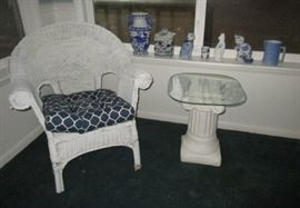 Wicker chair ad patio table, blue & white stoneware and ceramic pieces