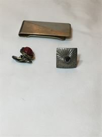 Gentleman's accessories: Money clip by Dante; sterling cufflink; and a unique cufflink of silver serpents entwined around a Scarab beetle carved from Carnelian.