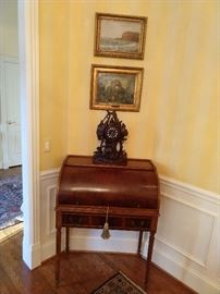 Antique English mahogany roll top desk, with hand carved Black Forest mantle clock.