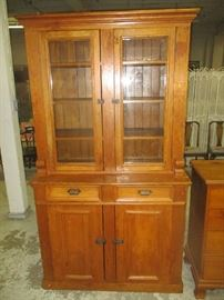 Antique step-back cupboard