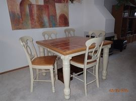 PUB TABLE WITH 6 CHAIRS AND A SELF STORING LEAF WITH A TILE TOP THIS IS AN AMAZING TABLE