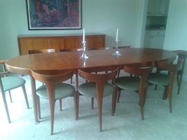 Mid Century Modern, Teak and bought in Germany in 1960. Table with 2 inserts, Credenza, 10 unique and collectable Chairs.