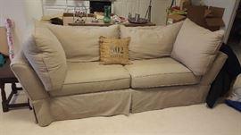 $150   Tan, 2 cushion sofa