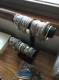 Mostly sterling silver bracelets in this photo