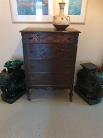 Antique chest of drawers with pair of ceramic elephant plant stands