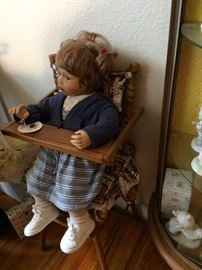 Antique wooden highchair with doll