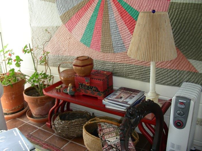 Baskets, plants, quilt, alabaster lamp, red coffee table