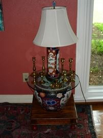 One of two Imari lamps, one of two fish bowls