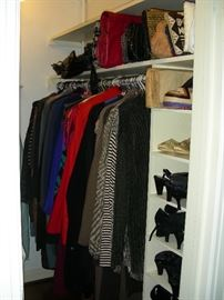There is tons of women's clothing, shoes, boots, purses and accessories. This is one half of multiple closets!