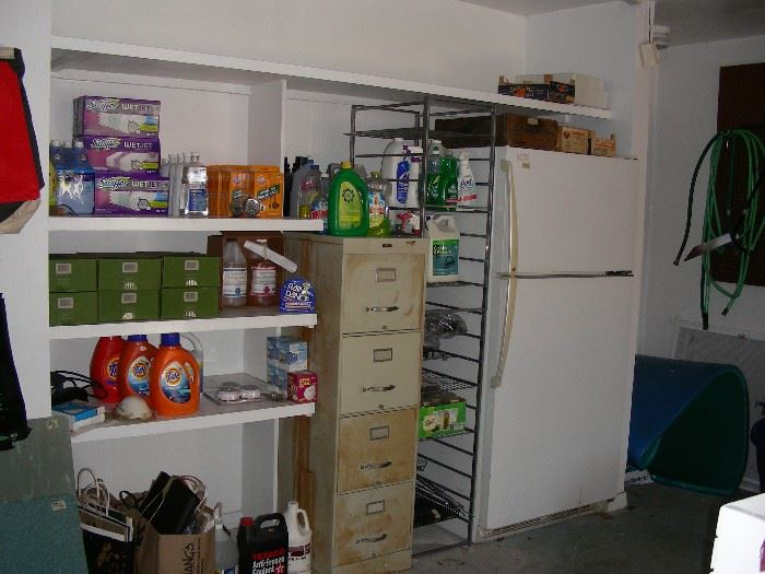 More cleaning supplies, file cabinet, refrigerator, Elfa shelves