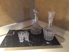 Decanters, marble cheese board and shot glasses