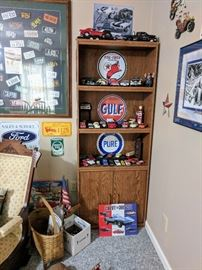 Diecast cars and metal signs